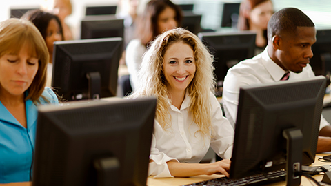 woman at computer smiling